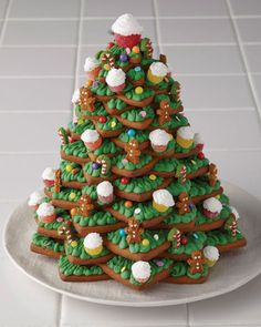 Use gingerbread cookie stars to assemble this gorgeous Christmas tree decorated with icing-covered gumdrops, sprinkles, and lots of frosting. Get the tutorial at Michaels Blog.