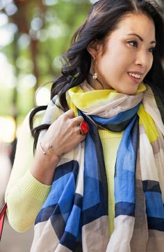 cute & little blog | petite fashion | spring outfit | neon yellow sweater, cobalt colorblock scarf, rolled jeans, amrita singh statement ring