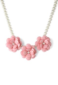 Pink Flower Pearl Necklace in pink. the mint version is super cute too! :)