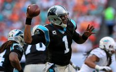 MIAMI GARDENS, FL - NOVEMBER 24: Cam Newton #1 of the Carolina Panthers passes during a game against the Miami Dolphins at Sun Life Stadium on November 24, 2013 in Miami Gardens, Florida. (Photo by Mike Ehrmann/Getty Images)