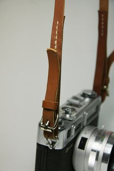 Simple Leather Camera Strap, still haven't found a good one maybe I have it made.