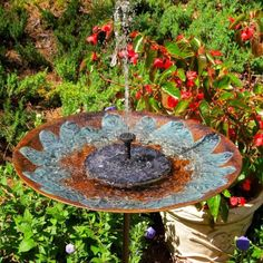 Entice more birds with moving water in your bird bath- solar fountain costs nothing to operate and really draws them in! Tall birdbath in handcrafted brass features verde-gris raised leaf motif on a 1