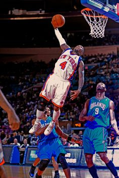 """NBA Slam Dunk champion Nate Robinson of the New York Knicks attempts a dunk against the Orlando Magic.  Robinson: 5'9"""", 43"""" vertical  Photo Courtesy MCT"""
