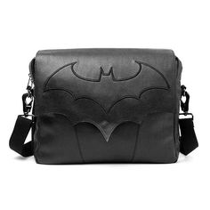 """Batman Arkham Knight Messenger Bag that'll make Bruce Wayne proud of you. Comes with an embroidered Batman logo on wing shaped front flap and adjustable strap. A must-have for any D.C fans or bat lovers. Includes 3 compartments for pens, phone, keys and a padded laptop divider. Made of PU faux leather with polyester lining. Measures 15.72"""" x 12.9"""" x 2.36"""" / 40 cm x 33 cm x 6 cm This Batman Arkham Knight Messenger Bag will stroke your ego instantly, knowing that you have the dark knight's…"""