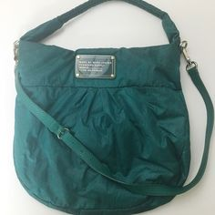 Marc Jacobs Handbag Green handbag that's been pre loved. The only wear is in the inside, the bottom is just faded and there's a couple of stains. The outside is in great condition except for the small stain (pictured) but I have not tried to wash it out yet. There is a small handle and then a larger detachable one. I can't find a tag that tells me the material, but I believe the outside is nylon. Marc by Marc Jacobs Bags