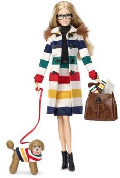 """Hudson's Bay® Barbie®  The Barbie Collection. Designer: Carlyle NueraRelease Date: 10/5/2016. Hudson's Bay Company, established in 1670, introduces Barbie with a modern Canadian fashion spirit for Fall 2016. The Hudson's Bay® Barbie® is an independent, creative spirit who follows these personal mantras: """"Strive to better yourself""""; """"wear your heart on your sleeve""""; """"be kind and be brave""""; and, most importantly, """"always seek adventure""""! This doll was designed in collaboration with the…"""