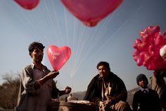 A Pakistani man prepares balloons for Valentine's Day on the street in Islamabad.