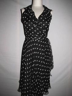 Gorgeous black and white polka dot wrap dress by Ralph Lauren.  This is a true wrap dress, done in luxurious silk and available in size 2.  The ruffle around the neck really sets it off!