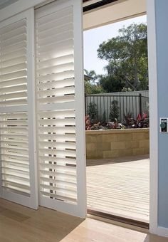 California Shutters are the most popular solution for a patio door. The bypass system allows you to slide the shutters side to side. They are connected by a panel track above so the shutters don't protrude into the room, making them the perfect option for tighter spaces.