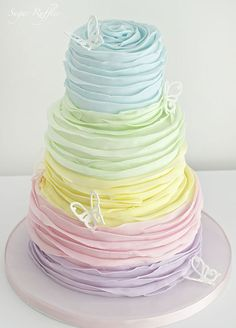 10 Pretty Spring Wedding Cakes: #4. Tiers of ruffled pastel perfection are the stuff wedding cake dreams are made of.