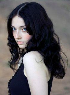 Is this her? Blue eyes, pale skin, black hair.