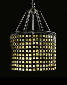"""Tiffany Studios A MONUMENTAL AND RARE """"CHAIN MAIL"""" CHANDELIER  favrile glass and patinated bronze  35 3/4 in. (90.8 cm) high 22 1/2 in. (57.2 cm) diameter of shade ca. 1910"""