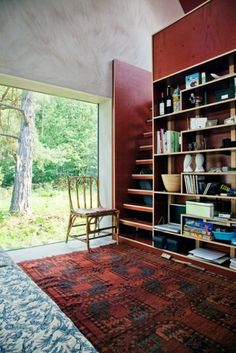 Bookshelves, wall, ladder, stairs