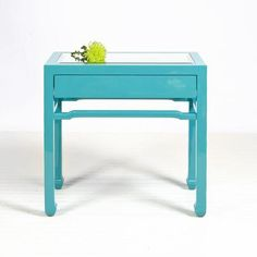 Click for Enlarged ViewTurquoise lacquer side table with one drawer on glides. Inset beveled mirror top. 975.00