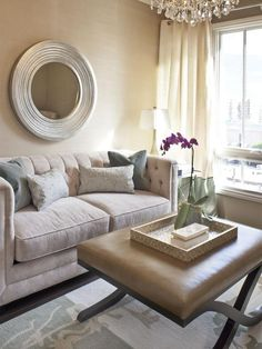 As An Ottoman In This Transitional Sitting Area Natural Light From A Large Window Brightens The Space And Illuminates Dazzling Crystal Chandelier