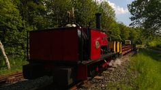 Our locomotive Alice on a trip out with some of our heritage wagons