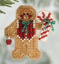 """MH186306 - Gingerbread Boy (2006) - Mill Hill - Seasonal Ornament / Pin Kits - Winter Holiday Kit Includes: Beads, treasures, perforated paper, pin back, floss, needles, chart and instructions. (1 of 6 designs in display Size: 2"""" x 2.25"""""""