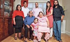 Family guys: Arvinder and Sarbjit (seated) with the other stars of Channel 4's The Family.