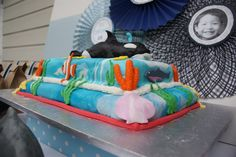 My cake for a friend's son on Catch My Party. Shamu and friends.