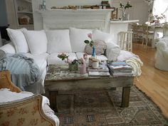 love the white sofa with the weathered wood table...I used to have that exact table back in the day...wish I still had it now!