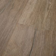 """This Aspen 7"""" x 48"""" Luxury Vinyl Plank is made of high quality vinyl material. It has the appearance of wood and comes in a lodge color.   Aspen 7"""" x 48"""" Lodge Vinyl Plank 23.67 sq. ft. by Mannington Adura Rigid"""