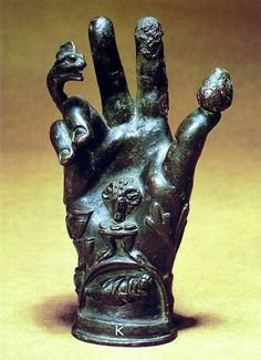 "Late Roman Empire. ""The Emblematic Hand of the Mysteries. A hand covered with numerous symbols was extended to the neophytes when they entered into the Temple of Wisdom. An understanding of the embossed upon the surface of the hand brought with it Divine power and regeneration Therefore, by means of these symbolic hands the candidate was said to be raised from the dead."""