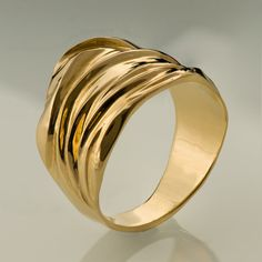 A handmade 14k gold ring made in a special technique giving it the shape and texture of textile in gold. Wedding rings are hard to choose, by now I am sure you have seen dozens of rings and maybe you even got the feeling you have seen the same ring with different designers. If you are