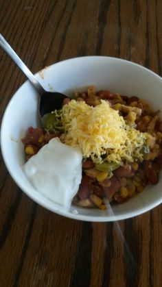 Crockpot Chicken Taco Soup.... Dice 1 lb chicken and saute. Drain 2 cans Pinto Beans, 2 cans Kidney Beans, and 2 cans Kidney Beans. Put all in crockpot. Dump 1 jar salsa, 1 taco seasoning mix, and 1 ranch packet in with other ingredients.  Cook on low 4-6 hrs. Garnish with cheese, sourcream, and sliced jalapeños.