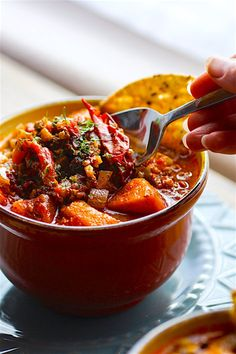 Crock Pot Paleo Sweet Potato Chipotle Chili! This chipotle Chili recipe is healthy but hearty, and has a kick of spice! Made with simple ingredients you probably already have in your fridge! A gluten free and paleo friendly chili made easy in the crock pot so you can be ready to serve with little effort .