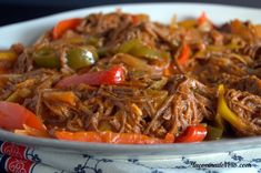 """Ropa Vieja (Shredded Flank Steak Stew) Ropa vieja means """"old clothes,"""" which the meat resembles when it is shredded. Although this dish is typically known as a Cuban dish each of the spanish speaking caribbean islands has their own version of Ropa Vieja. Cuban Recipes, Pork Recipes, Healthy Recipes, Puerto Rican Pork Recipe, Nicaraguan Food, Beef Flank Steak, Cuban Dishes, Cast Iron Recipes, Comida Latina"""