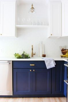 The Grit & Polish kitchen remodel - navy Shaker style bottom cabinets and white uppers