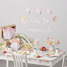 Brimming with cheerful prints, our Meri Meri Mermaid Party Decorations are sure to make a splash at any celebration. The mermaid party supplies include party plates, party napkins, party cups, garland and a cupcake kit. The items are overflowing with colorful mermaids, shells and other aquatic prints.