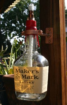 Makers Mark Bourbon Wisky Wiskey Tiki Torch / Oil by JadaNJace, $24.99 Drink up in your yard and have a party with this unique lamp.