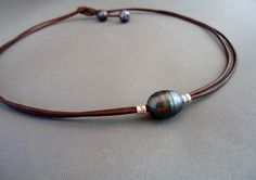 Black pearl on leather and sterling silver by iseadesigns on Etsy, $28.50