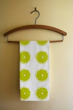 Kitchen tea towel with green limes cotton twill by NewCreatioNZ, $26.00