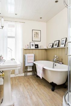 neutral and traditional ~ cosy bathroom...  **Liking the low shelf/picture rail...KMC**