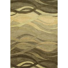 A soft color palette lends added charm to this handmade rug. Constructed of New Zealand wool, this contemporary rug is finished with a bold abstract print.