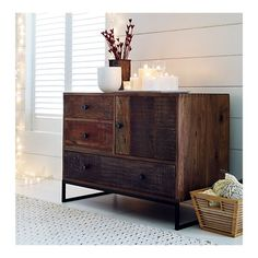As long as we're day dreaming... Atwood Chest in Chests, Cabinets | Crate and Barrel $1599 walnut and reclaimed wood.