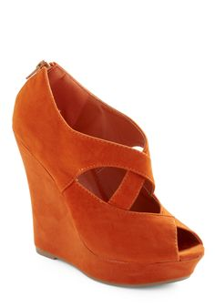Clementine-colored wedge! Constructed from soft vegan faux suede, this open toe design features a pair of curving, crossed straps. So lovely and feminine.
