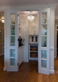 This quaint butler's pantry holds all the accessories needed to host a party, including glass dispensers, pastry stands and small plates. There's even a coffee maker to prepare your morning or afternoon coffee.