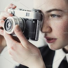 girl photographed on an old camera by Aleshyn Andrei on @creativemarket