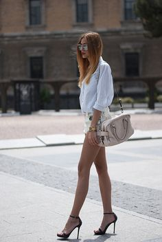 Stunning long legs in short shorts and ankle strap high heels working their way across the street.