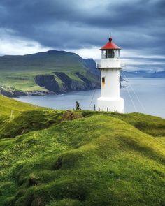 """Mykines lighthouse, Faroe Islands // Маяк на острове Микинес, называемом также """"птичьем"""" из за огромной нетронутой человеком популяции атлантических тупиков и других птиц  Фарерские острова - #фарерскиеострова #фареры #скандинавия #natgeomagazineru #природа #путешествие #европа #faroeislands #gasadalur #føroyar #færøyene #færøerne #faroes #skandinavia #bestofscandinavia #natgeoru #natgeotravel #natgeotravelpic #adventure #trip #travel #travelphotography #nature #bestvacations…"""