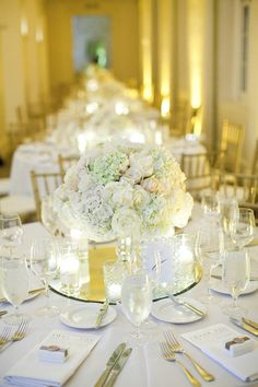 Low centerpiece, mirror base, surhttp://pinterest.com/mausin/wedding-centerpiece/#rounded by votives -- so simple and so pretty.