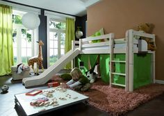 This reminds me of my brothers room growing up! He had a bunk bed with a trap door and a slide. Such great memories!!!
