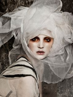 Intriguing use of color around the eyes.  Radiates depth, a kind of loneliness.