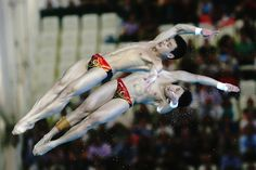 Yuan Cao and Yanquan Zhang of China compete in the Men's Synchronised 10m Platform Diving on Day 3 of the London 2012 Olympic Games at the Aquatics Centre on July 30, 2012 in London, England. (Photo by Clive Rose/Getty Images)