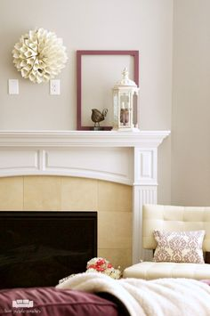 Simple and rustic Spring mantel decor. How to decorate your mantel for spring with simple home decor items - mason jars, birds, and rustic wooden spools.