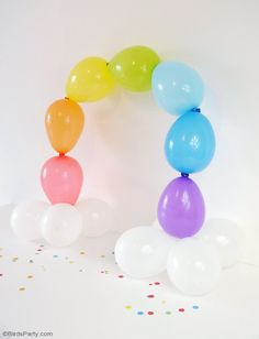 DIY Easy Rainbow Balloon Arch - make this party decor for your Saint Patrick's Day celebrations or a colorful birthday party, without the need for helium or wire frames!