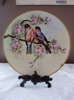 For your consideration, I am offering this exquisite, early 1900s, hand-painted 10 5/8 inch diameter Charger Wall or Cabinet Curio Plate